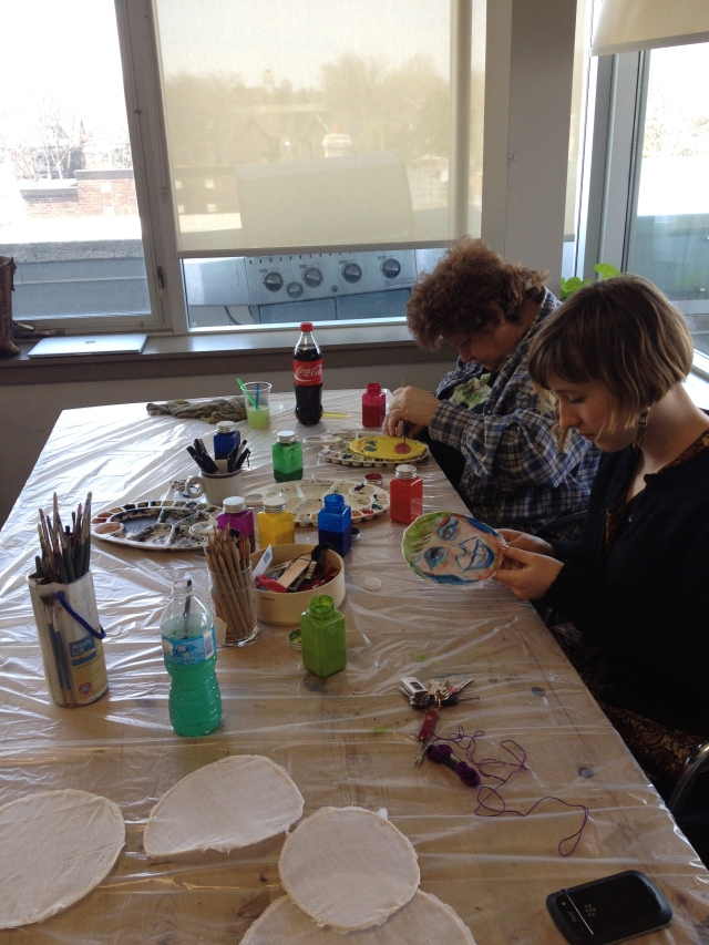 Donna and Jess paint fabric panels